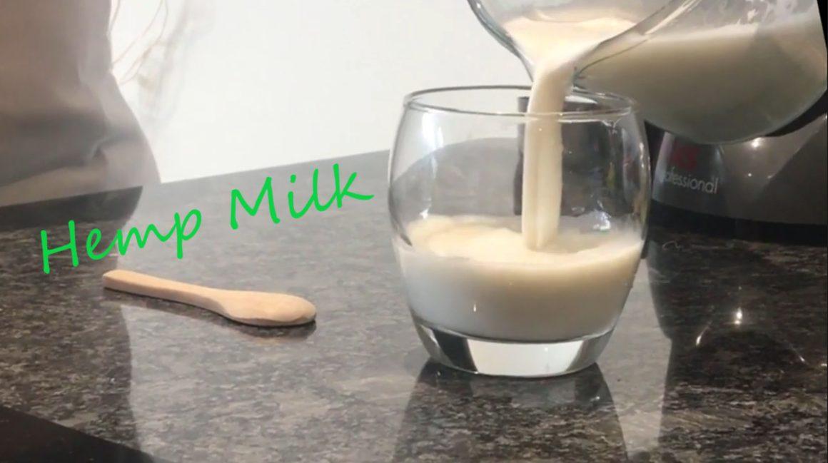 Glass of hemp milk being poured